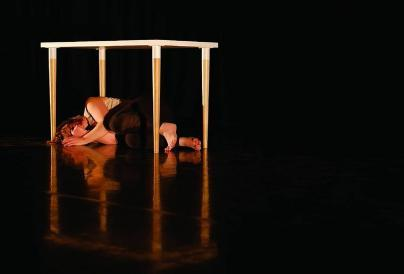 Dancer lying under a table