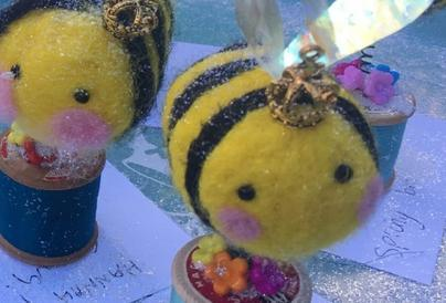 An image of two handcrafted bees