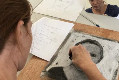 An image of a self-portrait being drawn