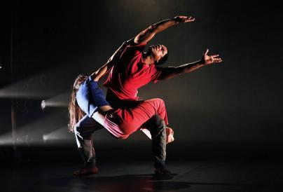 An image of two dancers dancing together