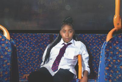 School girl sat at back of bus