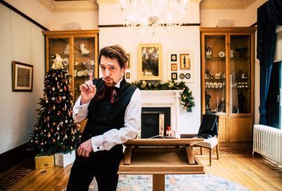 actor in wardown looking at camera